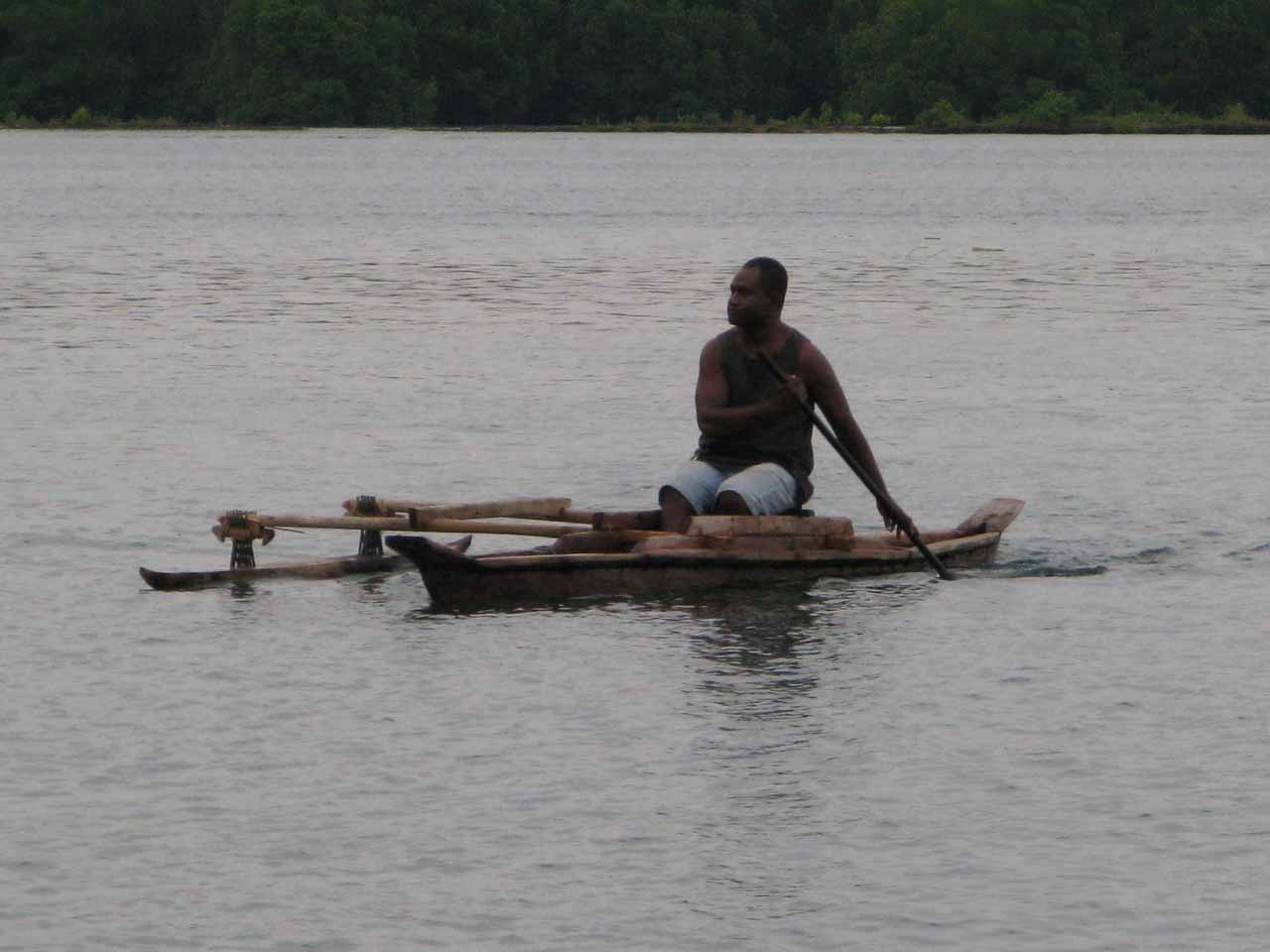 Bad shot of my neighbor in his canoe