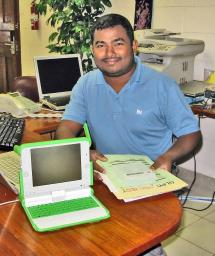 Chandana Silva with an OLPC