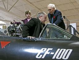 Hans gets into the cockpit of a CF-100