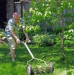 Hans mowing his lawn