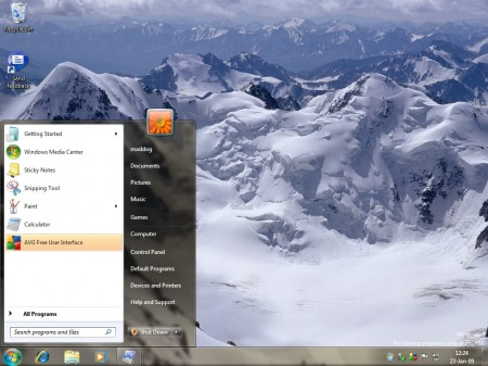 "Windows 7 desktop with ""Landscape"" theme and start menu showing"
