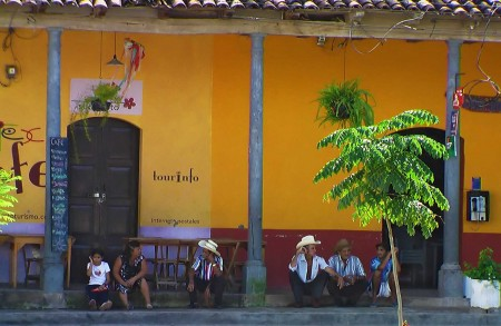 El Salvador - men gossiping in the village of Suchitoto - Heidi Majano