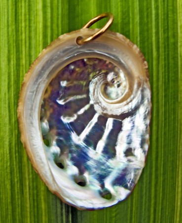 A finished abalone pendant