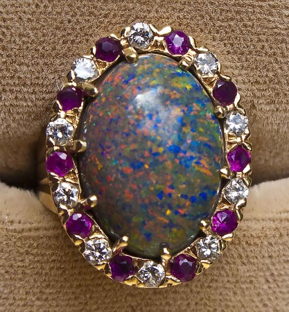An opal, diamond and natural ruby ring made for Eunie by my father