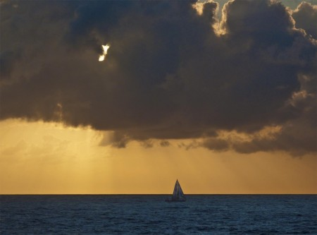 Sailboat at sunrise on Astrolabe Bay