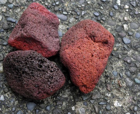 Three bits of volcanic pumice belched from the Manam Island volcano