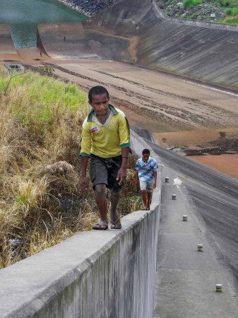 Schoolboys walking home on the edge of Yonki Dam