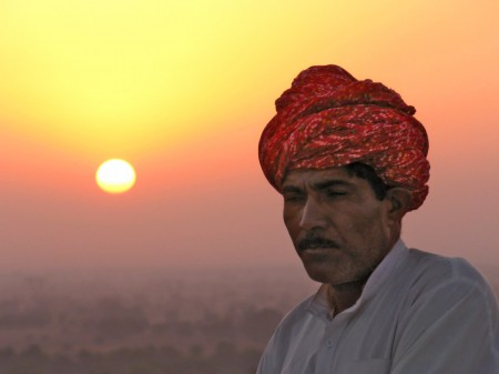 Indian Man at Sunrise by Val Jerram