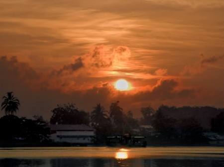 Madang sunrise with copra boat heading to Kar Kar Island