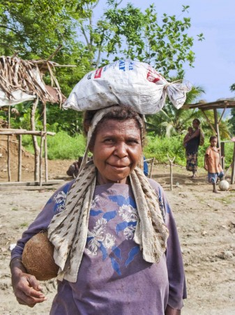 Woman with a bag of betel nut on her head