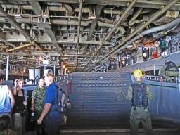 Inside the 'garage' of the USS Peleliu