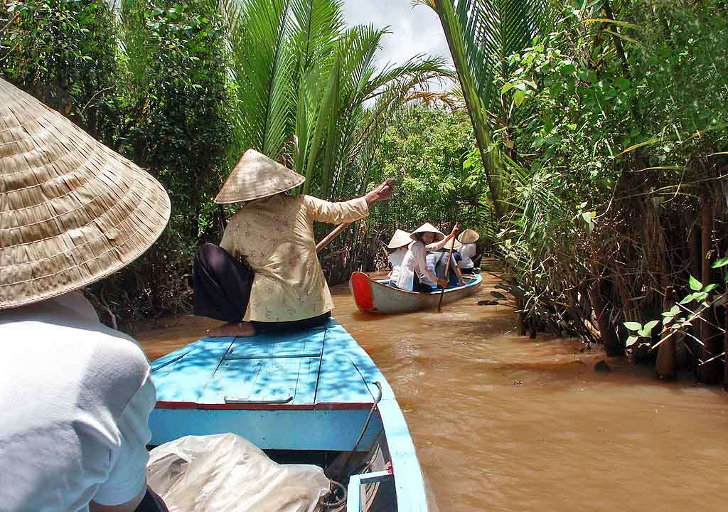 Canoes to the village on the Mekong Delta