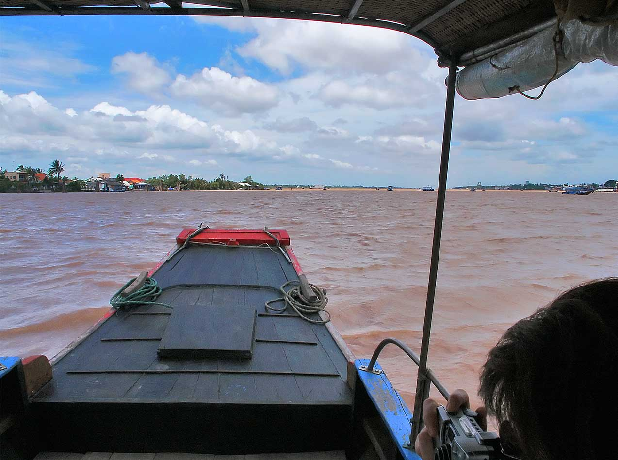 Our transport across the broad Mekong River