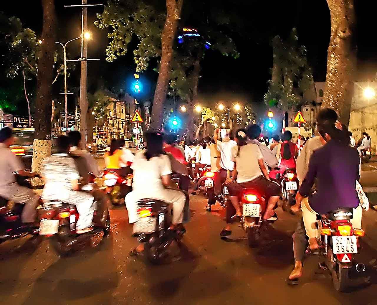 The motorbike brigade on night maneuvers - Siagon