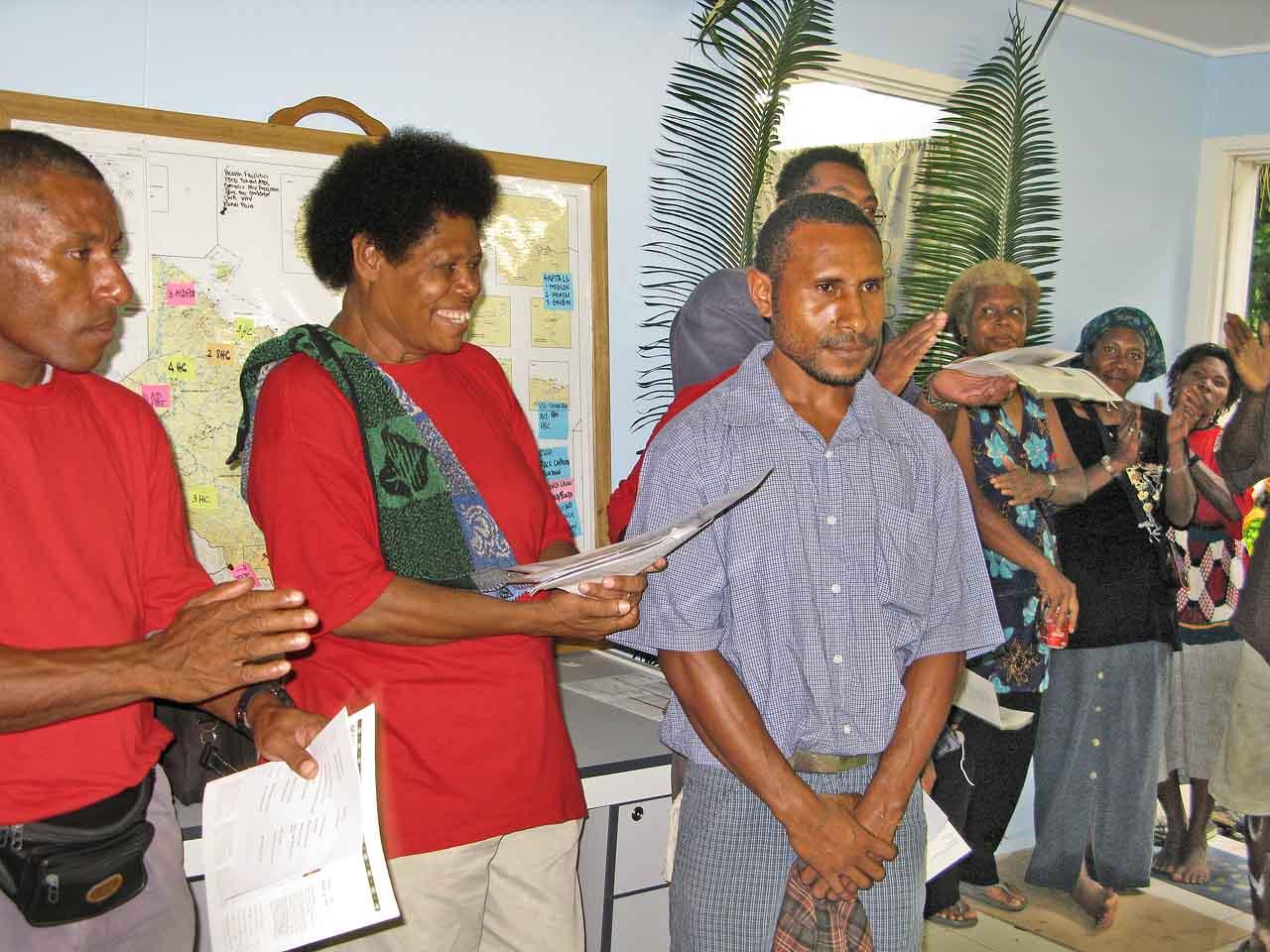 Matricia Mari (HRC) Congratulates Ritchie Garkana, winner of the Art Competition